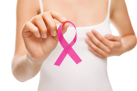 cancer symbol: Woman with a pink breast cancer awareness ribbon Stock Photo