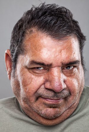 wrinkled: Closeup portriat of an elderly man Stock Photo