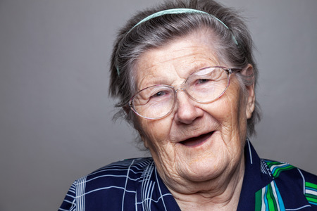 Closeup portrait of an elderly woman with glasses Stock Photo