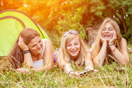 best group: Group of best friends enjoying a camping holiday Stock Photo