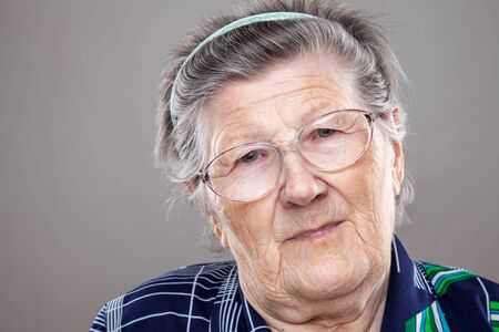 senior female: Closeup portrait of an elderly woman with glasses Stock Photo