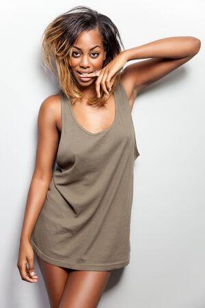brown skin: Young beautiful woman wearing a tank top Stock Photo