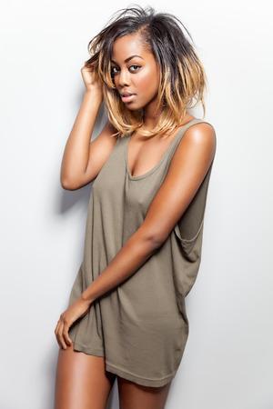 pretty black woman: Young beautiful woman wearing a tank top Stock Photo