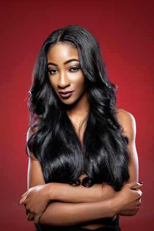 silky hair: Black beautiful woman with long luxurious shiny hair Stock Photo