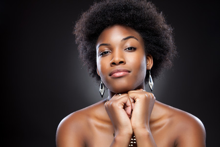 natural make up: Young black beauty with afro hairstyle