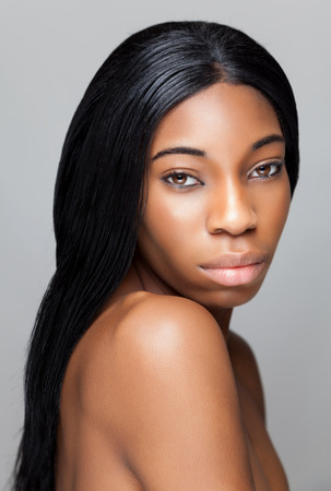 white face: Young black beauty with perfect skin Stock Photo