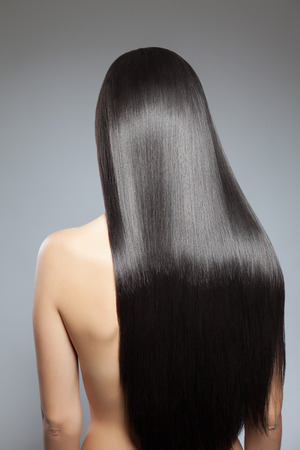 silky hair: Back view of a woman with long straight hair