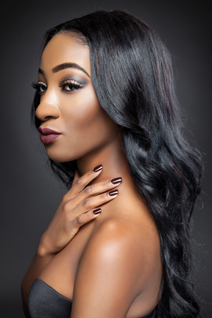 silky hair: Young black beauty with elegant long curly hair Stock Photo