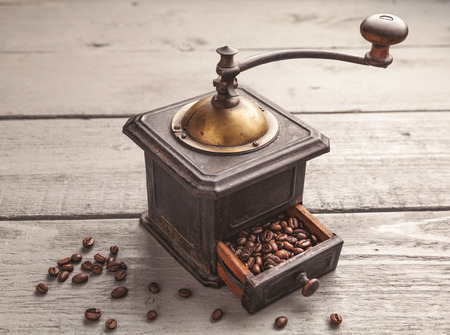coffee blender: Vintage coffee blender on a wooden table Stock Photo