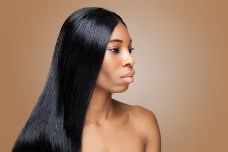 shiny black: Beautiful young black woman with long straight hair