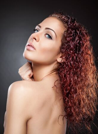 perfect waves: Beautiful young woman with red curly hair Stock Photo