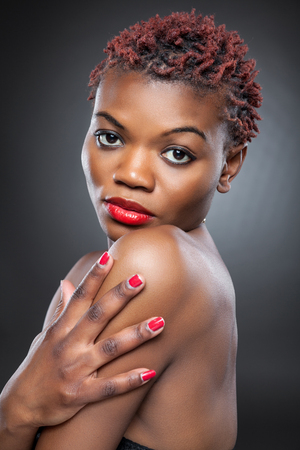 red hair beauty: Black beauty with short spiky red hair Stock Photo