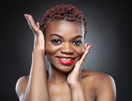 brown skin: Black beauty with short spiky red hair Stock Photo