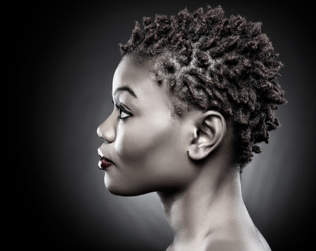 afro hair: Black beauty with short spiky red hair Stock Photo