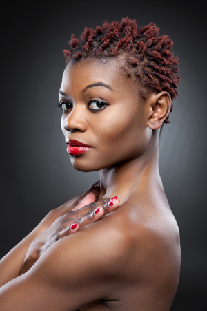 spiky hair: Black beauty with short spiky red hair Stock Photo
