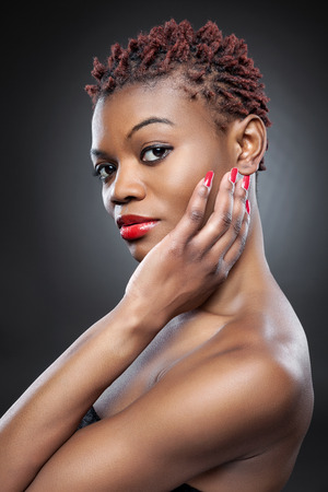 natural face: Black beauty with short spiky red hair Stock Photo