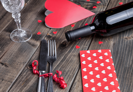 wine and dine: Romantic dinner set on rustic wooden background Stock Photo