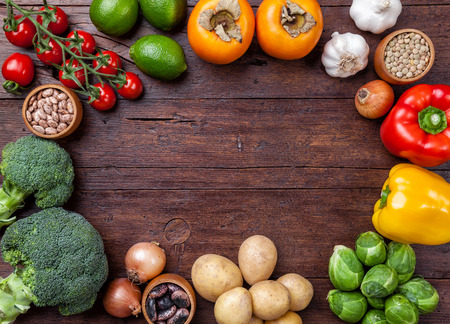 recipe background: Fresh and healthy organic vegetables and food ingredients on wooden background Stock Photo