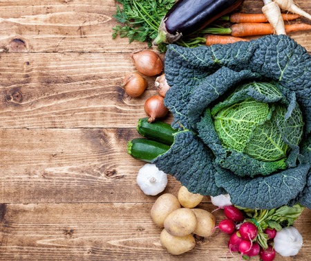 savoy cabbage: Fresh and organic bio vegetables on a wooden background Stock Photo