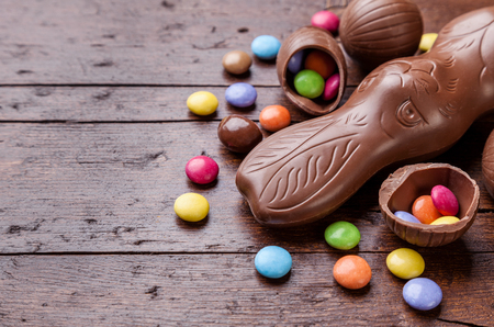 chocolate eggs: Delicious chocolate easter eggs and sweets on wooden background