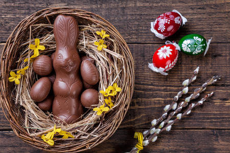 bunnies: Traditional Easter eggs on a wooden background