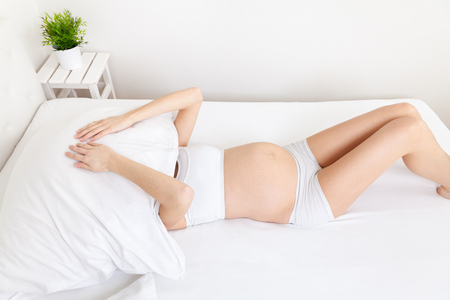 Expectant mother with sleeping problems during pregnancy