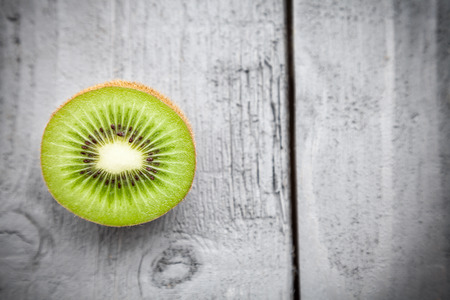 Delicious and healthy kiwi fruit on grey wooden background