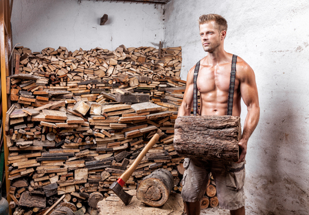 Shirtless handsome and muscular lumberjack with an axe Stock Photo