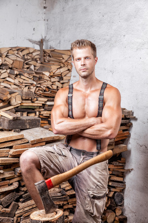 lumberman: Shirtless handsome and muscular lumberjack with an axe Stock Photo