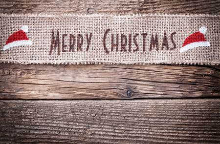 wood sign: Christmas ribbon on wooden background with copy space