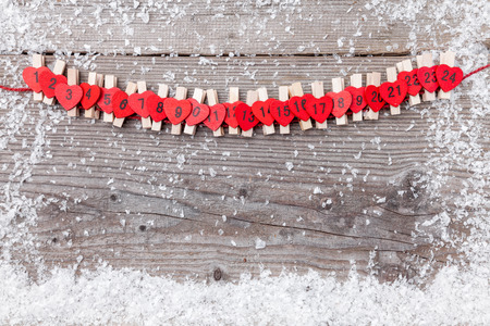 Traditional Christmas advent calendar with snow