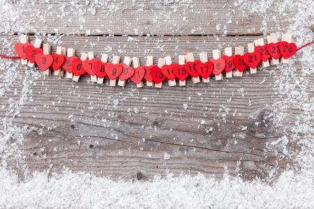 Traditional Christmas advent calendar with snow