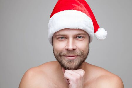 beard man: Portrait of a handsome man with beard wearing a Christmas hat Stock Photo