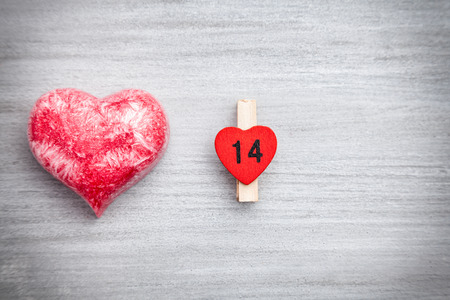 14: Love concept. Heart on grey rustic background