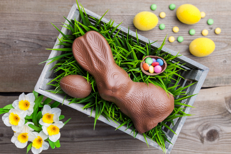 Traditional Easter decoration background with flowers, Easter bunnies and eggs Stock Photo