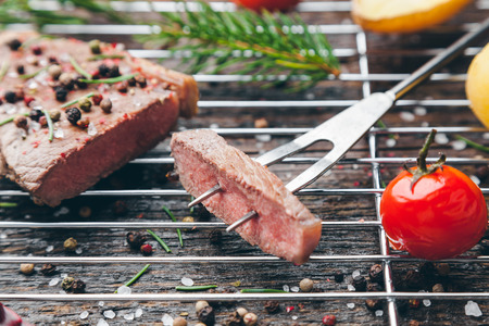 spice: Delicious grilled beef steak with seasoning on wooden background