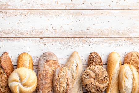 Delicious freshly baked bread on wooden background Stock Photo - 96465856