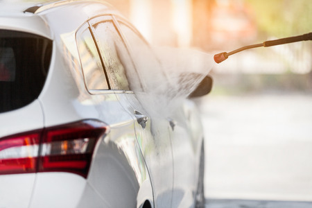 Cleaning the car with the high pressure car wash washer