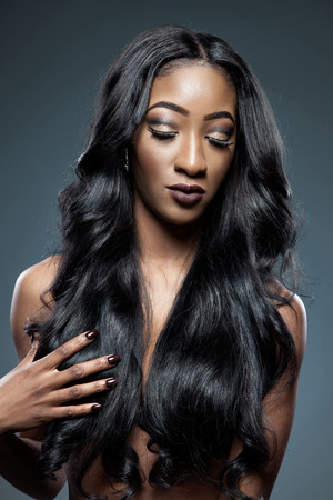 Black beautiful woman with long luxurious shiny hair Banque d'images