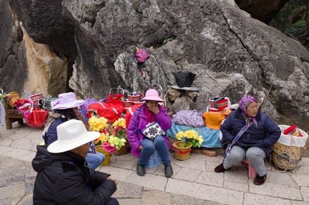 Kunming, Yunnan, China - 31 December 2017: A group of Chinese tourist guides in the Stone Forest (Shilin)