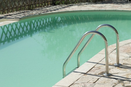 Isolated pool ladder - Swimming pool details (Marche, Italy, Europe) Stock Photo