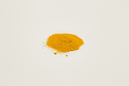 Isolated curcuma powder on a white background (Pesaro, Italy, Europe)