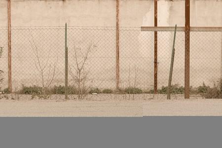 Metallic fence of an abandoned building (Pesaro, Italy, Europe)