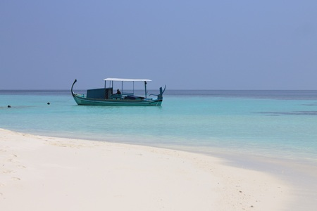 Isolated traditional Maldivian boat called