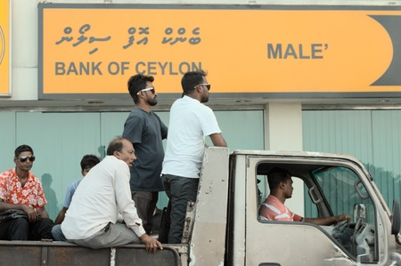 Male, Maldives - 20 December 2018: Men in a pick-up on the road