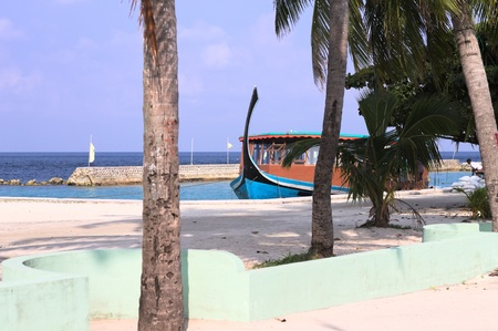 Typical Maldivian boat called 'Dhoni' in the harbor (Ari Atoll, Maldives)