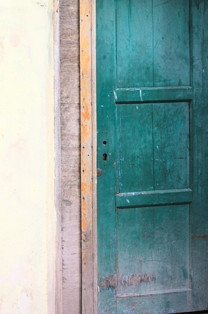 Green door and yellow wall