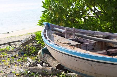 Isolated wooden boat on the beach (Ari Atoll, Maldives)