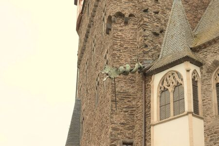 Ornamental dragon on the roof of a medieval tower