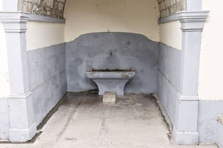 Isolated drinking fountain in an old building (Porto Santo, Portugal)